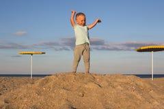 Gagnant d'enfant sur le dessus du thehill Photo stock