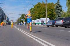 Gagnant de la course pour la concurrence de la vie pendant l'activité de gens du pays de jour de ville Photos stock
