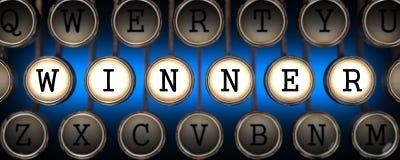 Gagnant sur les clés de la vieille machine à écrire. Photo libre de droits