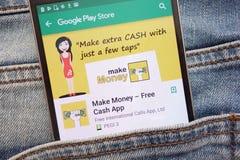 Gagnez l'argent - l'appli libre d'argent liquide sur le site Web de Google Play Store montré sur le smartphone caché dans des jea images libres de droits