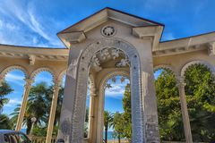 Arch of Colonnade in Gagra, Abkhazia, backlit against the sky,. Gagra, Abkhazia, 01.12.2017  Arch of Colonnade in Gagra, Abkhazia, backlit against the sky Royalty Free Stock Images