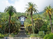 Gagra. Gagripsh restaurant in the city of Gagra, surrounded by palm trees Stock Image