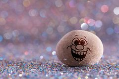 The gaiety stone emoji. Emotions on color glitter boke background stock image
