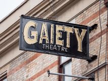 Gaiety Theatre sign in Dublin, on front facade. Gaiety Theatre sign in Dublin, Ireland on front facade seen from the street, attached to exterior wall stock photo
