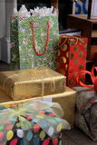 Gaily wrapped packages and gift bags on table Royalty Free Stock Image