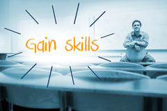 Gain skills against lecturer sitting in lecture hall Stock Photos