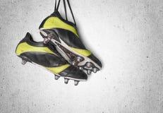 Gaines du football Bottes du football d'isolement en fonction Image stock