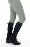 Gaines et culasses s'usantes d'équitation de femme Photographie stock libre de droits