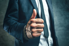 Gaining bosses approval, businessperson gesturing thumb up Royalty Free Stock Photography