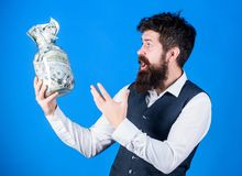 Gaining cash for his work. Excited businessman holding jar with cash money. Bearded man keeping cash holdings. Cash flow stock image
