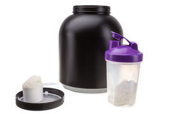 Gaining muscle mass. Protein and shaker for fitness and bodybuilding. Royalty Free Stock Photos