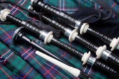 Gaitas en la falda escocesa Fotos de archivo libres de regalías