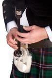 Gaitas y escarcela de los montañeses de Escocia Fotografía de archivo