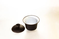 Gaiwan. The Chinese ceramic gaiwan for holding a tea ceremony on a white background Stock Image