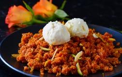 Gajar Halwa and ice cream. Gajar Halwacarrot pudding or Indian carrot cake made with carrots,sugar,milk and dryfruits Stock Image