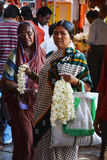 Gajra seller. Gajra is a flower garland which women in India wear during festive occasions, weddings or as part of everyday traditional attire. The women is Stock Photo