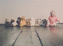 Galán con sus juguetes de la felpa imágenes de archivo libres de regalías