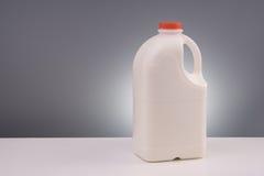 Galão plástico grande do leite fotografia de stock