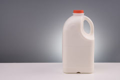Galão plástico grande do leite imagens de stock royalty free