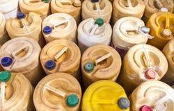 Galón plástico amarillo - Tailandia Imágenes de archivo libres de regalías