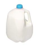 Gal.et mjölkar flaskan med det blåa locket som isoleras på vit Royaltyfri Fotografi