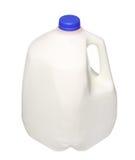 Gal.et mjölkar flaskan med det blåa locket som isoleras på vit Arkivfoto