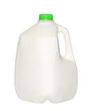 Gal.et mjölkar flaskan med det gröna locket som isoleras på vit Royaltyfria Bilder