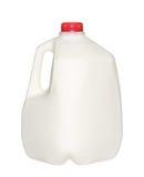 Gal.et mjölkar flaskan med det röda locket på vit Arkivfoto
