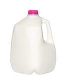 Gal.et mjölkar flaskan med det rosa locket på vit Arkivbild
