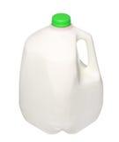 Gal.et mjölkar flaskan med det gröna locket på vit Arkivfoton