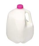 Gal.et mjölkar flaskan med det rosa locket som isoleras på vit Arkivfoto