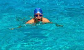 Gal swimming in a pool Stock Image