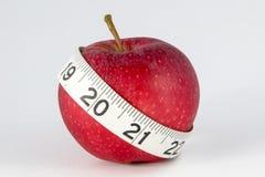 Gala Apple mit Maßband Stockbild