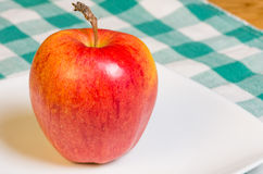 Gala apple on a white plate Royalty Free Stock Photography