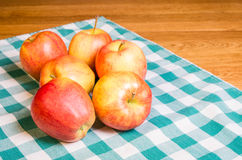 Gala apples on checked cloth Stock Image