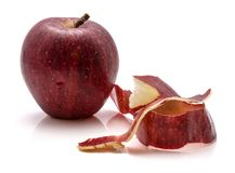 Gala Apples. One whole Gala apple with separated rind isolated on white background royalty free stock photos