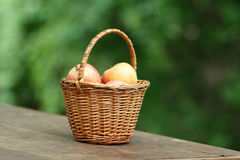 Gala apples in a wicker basket Royalty Free Stock Photos