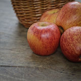 Gala apples and a wicker basket Royalty Free Stock Photo