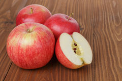 Gala apples on wood table Stock Image