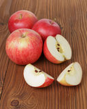 Gala apples on wood table Royalty Free Stock Photography
