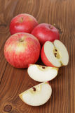 Gala apples on wood table Royalty Free Stock Images