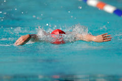 Gala swimmer. Boy swimming during a gala swimming event Stock Photo