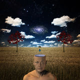 Galactic Mind. Open minded man receives influence from above in form of drop of liquid Royalty Free Stock Image