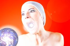 Galactic Scream. Young woman representing a galactic entity with the glowing earth before her, her mouth open and eyes wide with a replica of the earth visible royalty free stock images
