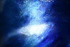 Galaktyki tło, kropi białego pył na zmroku - błękitny tło obrazy stock
