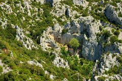Galamus gorge, and ancient hermitage. Galamus gorge, with an hidden ancient hermitage, Languedoc-Roussillon, France Royalty Free Stock Photos