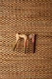 Galangal roots  on brown wallpaper showing texture of weave dried water hyacinth placemat. Stock Images