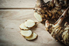 Galangal slice on wooden Royalty Free Stock Photography