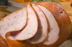 Galantine of chicken. Galantine of yellow stuffed chicken in slices Royalty Free Stock Images