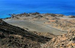 Galapagos Landscape. A boardwalk leads across a barren landscape Royalty Free Stock Images